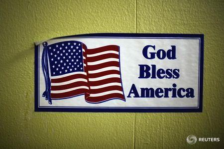 "A decal reading ""God Bless America"" is seen on the wall of the soup kitchen in the basement of the St. Leo Catholic Church in Detroit December 17, 2011. REUTERS/Mark Blinch"